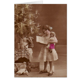 vintage girl with doll at christmas greeting card