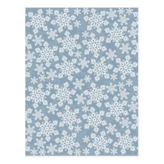 white snowflakes on blue postcard