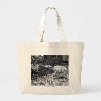 Woman bottle feeding an antelope. jumbo tote bag