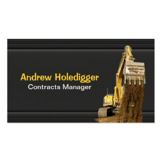 Yellow excavator on black pack of standard business cards