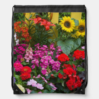 Yellow picket fence with flower garden in backpacks